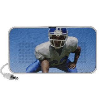 football player playing on a football field travel speaker