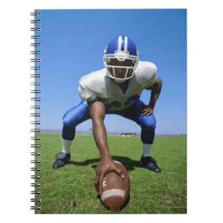 football player playing on a football field spiral notebook