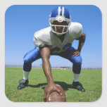 football player playing on a football field square sticker