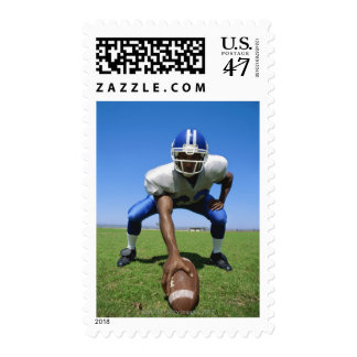 football player playing on a football field stamp
