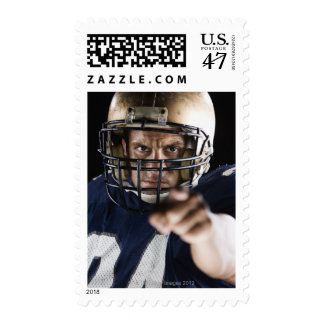 Football player pointing and looking intense postage
