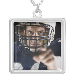 Football player pointing and looking intense silver plated necklace