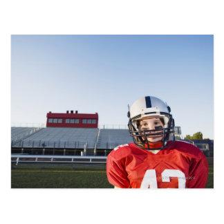 Football player posing on field postcard