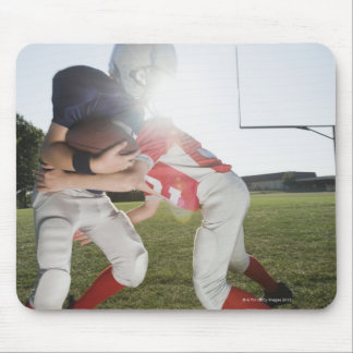Football player tackling opponent mouse pad