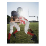 Football player tackling opponent postcard