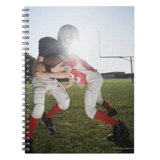 Football player tackling opponent spiral notebook