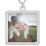 Football player tackling opponent square pendant necklace