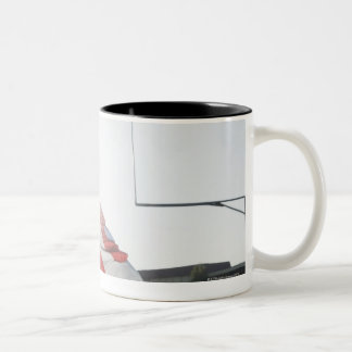 Football player tackling opponent Two-Tone coffee mug