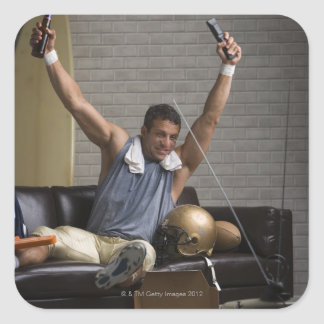 Football player watching football and cheering square sticker