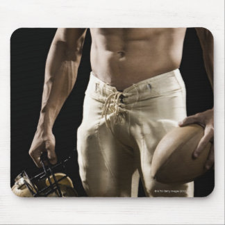 Football player with protective gear, football, mouse pad