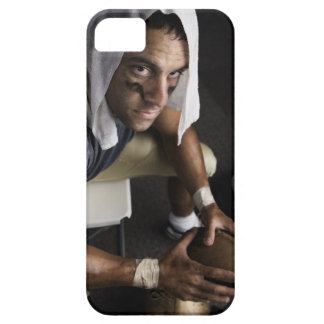 Football player with towel on head holding iPhone SE/5/5s case