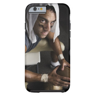 Football player with towel on head holding tough iPhone 6 case
