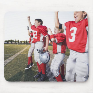 Football players cheering on sideline mouse pad