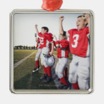 Football players cheering on sideline ornament