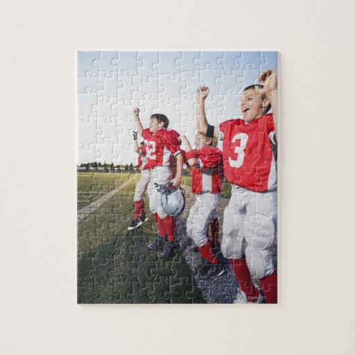 Football players cheering on sideline jigsaw puzzle