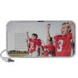 Football players cheering on sideline laptop speakers