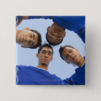 Football players huddled together button
