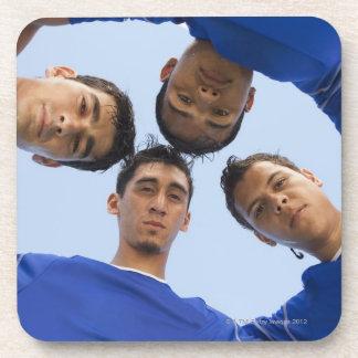 Football players huddled together coaster