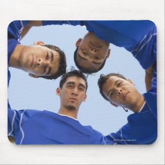 Football players huddled together mouse pad