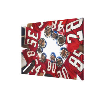Football Players in Huddle Canvas Print