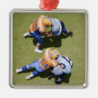 Football players playing football 2 metal ornament