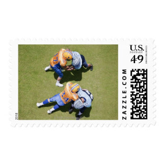 Football players playing football 2 postage