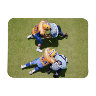 Football players playing football 2 rectangular photo magnet
