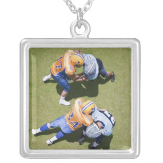 Football players playing football 2 square pendant necklace