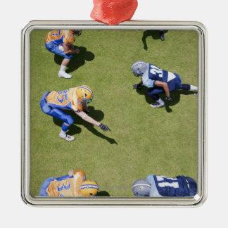 Football players playing football christmas tree ornament