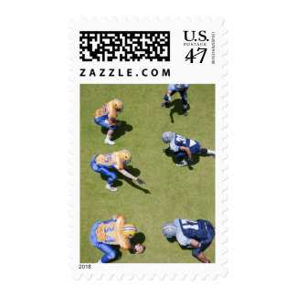 Football players playing football postage