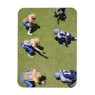 Football players playing football rectangular photo magnet