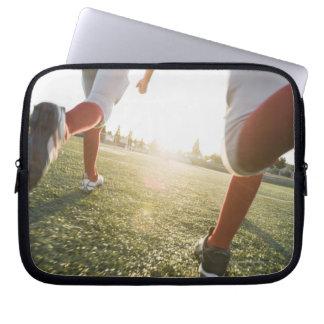 Football players running on field laptop computer sleeve