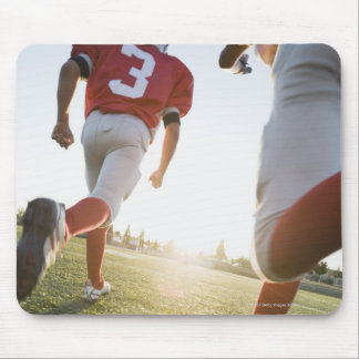 Football players running on field mouse pad