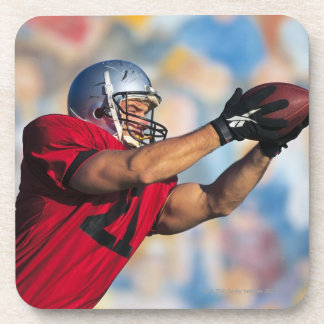 Football receiver catching ball coasters