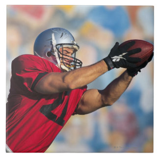 Football receiver catching ball tile