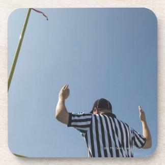 Football referee calling field goal coaster
