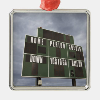 Football scoreboard and storm clouds. metal ornament