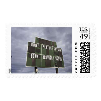 Football scoreboard and storm clouds. postage stamps