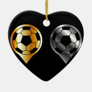 Footballs inside gold and silver placement ceramic ornament