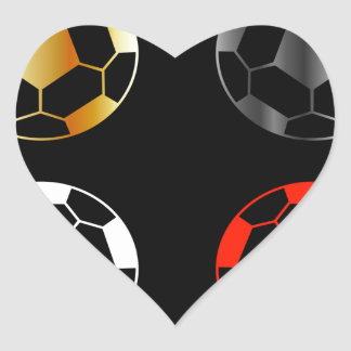 Footballs on black background heart sticker