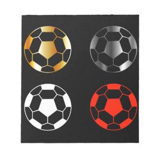 Footballs on black background notepad
