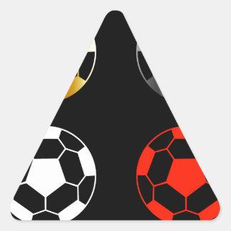 Footballs on black background triangle sticker