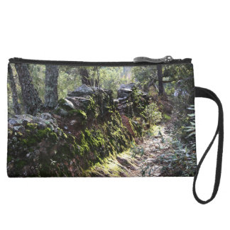 Footpath covered with nature in the mountain range suede wristlet