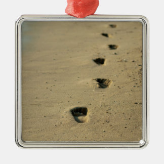 Footprints alongside the sea square metal christmas ornament