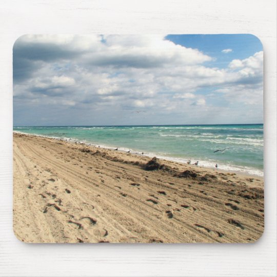 Footprints and ocean mouse pad