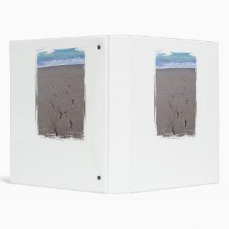 Footprints in beach sand blue ocean in back vinyl binders