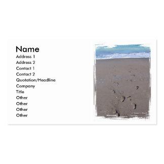 Footprints in beach sand blue ocean in back business card templates