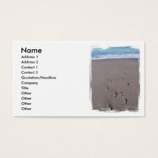 Footprints in beach sand blue ocean in back business card