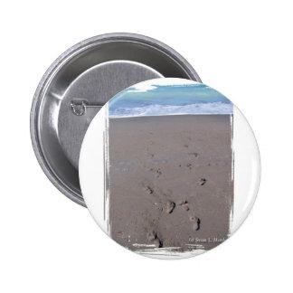 Footprints in beach sand blue ocean in back pinback button
