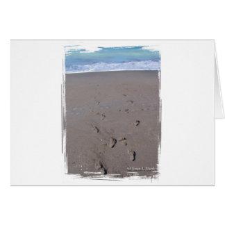 Footprints in beach sand blue ocean in back greeting cards